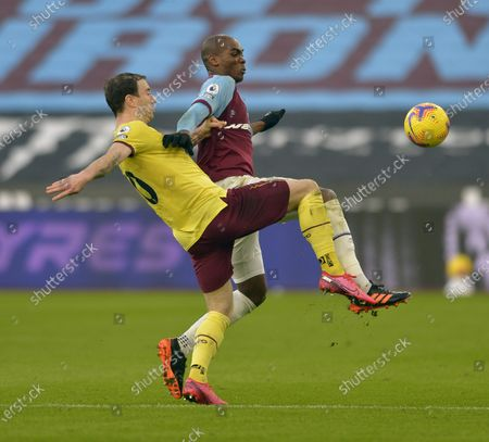 Angelo Ogbonna of West Ham United in action with Ashley Barnes of Burnley