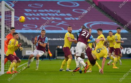 Angelo Ogbonna of West Ham United sees his header go on to hit the crossbar
