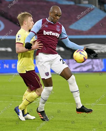 Angelo Ogbonna of West Ham United in action with Ben Mee of Burnley