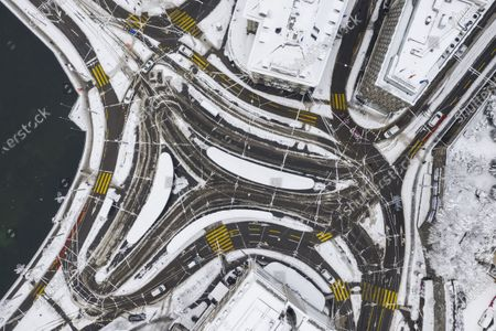 Stock Photo of An aerial picture taken with a drone shows View of the snow covered streets and streetcar tracks at Central square in Zurich, Switzerland, 15 January 2021. Record-breaking amounts of fresh snow have fallen in parts of Switzerland since Wednesday 13 January, with a massive impact on traffic.