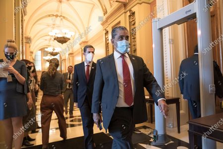 Stock Photo of From, Rep. Adriano Espaillat, D-N.Y., walks to the House chamber at the Capitol in Washington, as the House of Representatives pursues an article of impeachment against President Donald Trump for his role in inciting an angry mob to storm the Capitol last week. Espaillat, 66, announced on Thursday he had tested positive for the coronavirus after lawmakers were corralled into secure locations during last week's siege