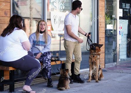 Stock Photo of Emma Slater and Sasha Farber with dog