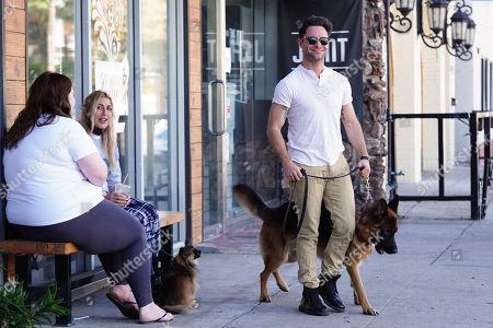 Emma Slater and Sasha Farber with dog