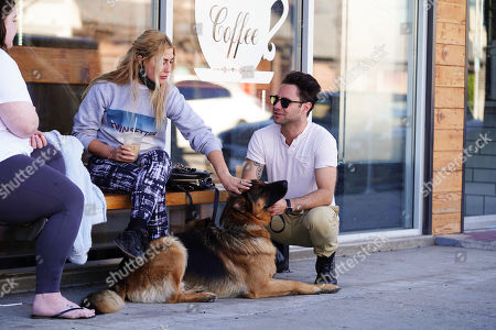 Stock Picture of Emma Slater and Sasha Farber with dog