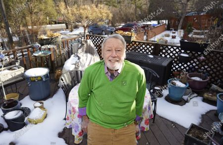Stock Image of Howard Jones, an 83-year-old veteran, talks about his struggle to secure a COVID-19 vaccination in El Paso County while seated on the deck outside his home, in southwest Colorado Springs, Colo. Not having internet in his home, Jones ended up getting help from a friend to get an appointment for the vaccine in Colorado Springs