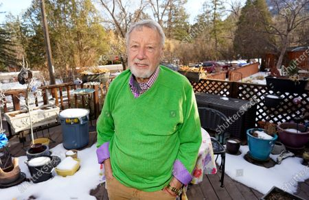 Howard Jones, an 83-year-old veteran, talks about his struggle to secure a COVID-19 vaccination in El Paso County while seated on the deck outside his home, in southwest Colorado Springs, Colo. Not having internet in his home, Jones ended up getting help from a friend to get an appointment for the vaccine in Colorado Springs