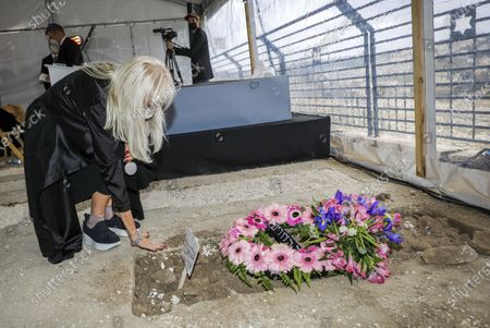 Stock Picture of Miriam Adelson, mourns next to the grave of her husband, Sheldon Adelson, in Jerusalem, during his funeral