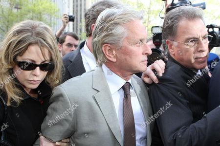 Michael Douglas and Diandra Douglas leaving the court