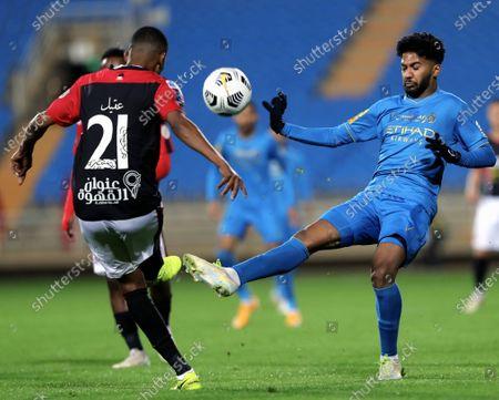 Al-Raed's player Aqel Al-Sahbi (L) in action against Al-Nassr's Khalid Al-Ghannam (R) during the Saudi Professional League soccer match between Al-Raed and Al-Nassr at King Abdullah Sports City Stadium, in Buraidah, Saudi Arabia, 15 January 2021.
