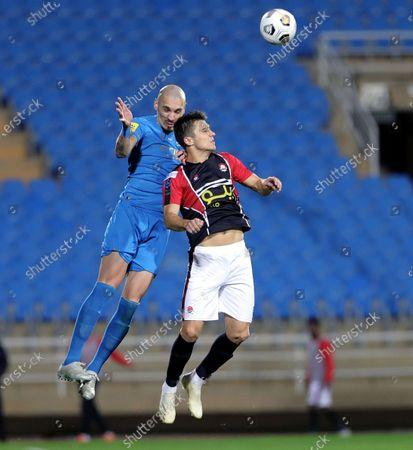 Al-Raed's player Nemanja Nikolic (R) in action against Al-Nassr's Maicon (L) during the Saudi Professional League soccer match between Al-Raed and Al-Nassr at King Abdullah Sports City Stadium, in Buraidah, Saudi Arabia, 15 January 2021.
