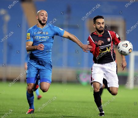 Al-Raed's player Khalid Al-Khathlan (R) in action against Al-Nassr's Nordin Amrabat (L) during the Saudi Professional League soccer match between Al-Raed and Al-Nassr at King Abdullah Sports City Stadium, in Buraidah, Saudi Arabia, 15 January 2021.
