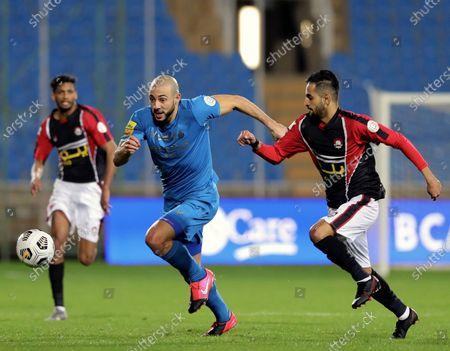 Al-Raed's player Khalid Al-Khathlan (R) in action against Al-Nassr's Nordin Amrabat (2-L) during the Saudi Professional League soccer match between Al-Raed and Al-Nassr at King Abdullah Sports City Stadium, in Buraidah, Saudi Arabia, 15 January 2021.