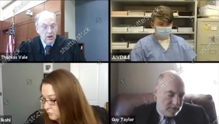 Logan T. Kruckenberg-Anderson, 16, top right, appears by video conference in Green County, Wis. Circuit Court on with Circuit Judge Thomas Vale, top left, Assistant District Attorney Laura Kohl and assistant state public defender Guy Taylor. Prosecutors say Kruckenberg-Anderson has admitted fatally shooting his newborn daughter and leaving her body inside a fallen tree in the woods in southern Wisconsin. Logan Kruckenburg-Anderson is charged as an adult with first-degree intentional homicide and hiding a corpse