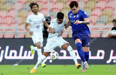Al-Ahli's player Hussain Al Moqahwi (2-L) in action against Al-Hilal's Hyun Soo Jang (R) during the Saudi Professional League soccer match between Al-Ahli and Al-Hilal at King Abdullah Sport City Stadium, 30 kilometers north of Jeddah, Saudi Arabia, 15 January 2021.