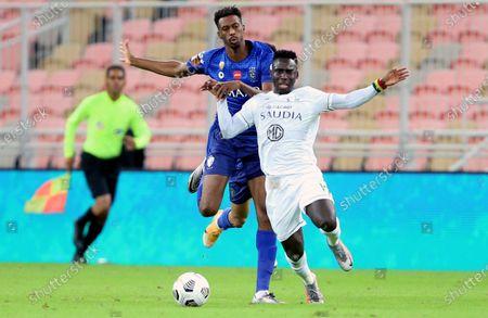 Al-Ahli's player Samuel Owusu (R) in action against Al-Hilal's Mohamed Kanno (L) during the Saudi Professional League soccer match between Al-Ahli and Al-Hilal at King Abdullah Sport City Stadium, 30 kilometers north of Jeddah, Saudi Arabia, 15 January 2021.