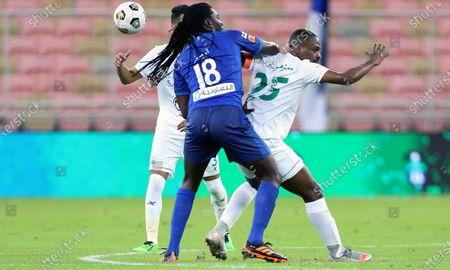 Al-Ahli's player Motaz Hawsawi (R) in action against Al-Hilal's Bafetimbi Gomis (L) during the Saudi Professional League soccer match between Al-Ahli and Al-Hilal at King Abdullah Sport City Stadium, 30 kilometers north of Jeddah, Saudi Arabia, 15 January 2021.
