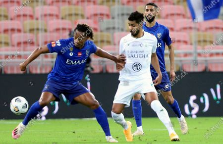Al-Ahli's player Hussain Al Moqahwi (R) in action against Al-Hilal's Andre Carrillo (L) during the Saudi Professional League soccer match between Al-Ahli and Al-Hilal at King Abdullah Sport City Stadium, 30 kilometers north of Jeddah, Saudi Arabia, 15 January 2021.