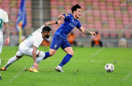Al-Ahli's player Lucas Lima (L) in action against Al-Hilal's Hyun Soo Jang (R) during the Saudi Professional League soccer match between Al-Ahli and Al-Hilal at King Abdullah Sport City Stadium, 30 kilometers north of Jeddah, Saudi Arabia, 15 January 2021.