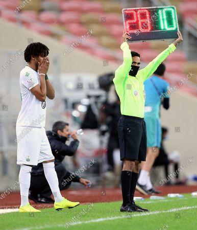 Al-Ahli's player Salman Al-Muwashar (L) gets substituted during the Saudi Professional League soccer match between Al-Ahli and Al-Hilal at King Abdullah Sport City Stadium, 30 kilometers north of Jeddah, Saudi Arabia, 15 January 2021.