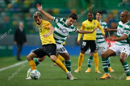 Sporting's player Pedro Goncalves  (2-L) in action against Fabio Coentrao (L) of  Rio Aveduring the Portuguese First League soccer match Sporting Lisbon vs Rio Ave held at Alvalade Stadium in Lisbon, Portugal, 15 January 2021.