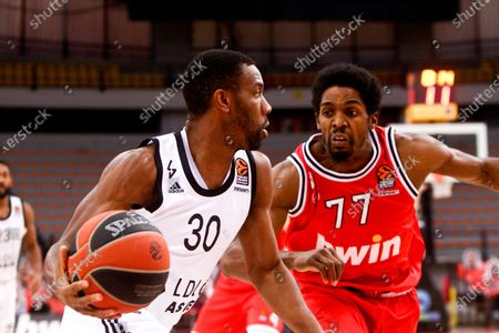 Shaquielle McKissic of Olympiacos Piraeus competes with Norris Cole of LDLC Asvel Villeurbanne during the Euroleague Basketball match between Olympiacos Piraeus and LDLC Asvel Villeurbanne at the SEF Stadium in Piraeus, Greece, 15 January 2021.