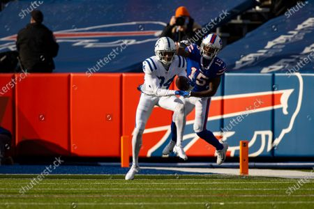 Indianapolis Colts cornerback Isaiah Rodgers (34) intercepts the ball against Buffalo Bills wide receiver John Brown (15) on a play that would be overturned due to penalty during the second quarter of an NFL wild-card playoff football game, in Orchard Park, N.Y