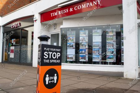 A Buckinghamshire Council Covid-19 Play your part stop the spread sign outside the Tim Russ & Company Estate Agents