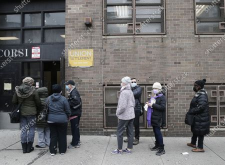 Outpatients wait on line outside to receive a COVID-19 vaccine when Secretary of State Rossana Rosado and New York State open another New York State vaccination site at Corsi Houses in East Harlem in New York City on Friday, January 15, 2021.