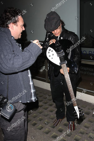 Editorial photo of Adam Ant playing a guitar outside Gallery 27 Cork Street, London, Britain - 20 Apr 2010
