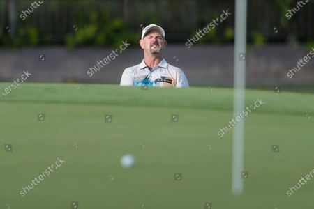 Rory Sabbatini watches his ball near the pin after a shot onto the 18th green during the second round of the Sony Open golf tournament, at Waialae Country Club in Honolulu