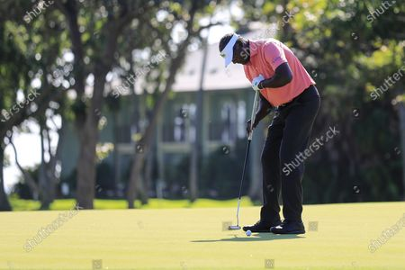 Vijay Singh putts on the 10th green during the second round of the Sony Open golf tournament, at Waialae Country Club in Honolulu
