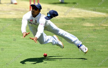 Mayank Agarwal of India drops a catch off the batting of Mitchell Starc of Australia during day two of the fourth Cricket Test Match between Australia and India at the Gabba in Brisbane, Australia, 16 January 2021.