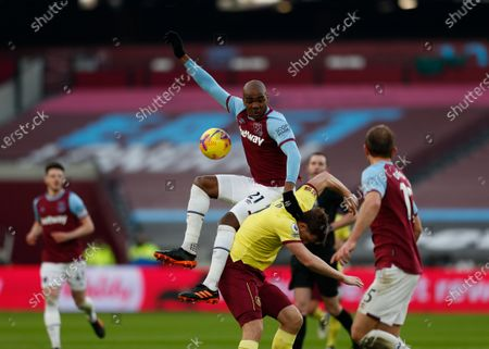 Angelo Ogbonna of West Ham United challenges Chris Wood of Burnley from a cross in the box; London Stadium, London, England; English Premier League Football, West Ham United versus Burnley.