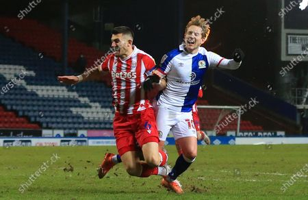 Stock Image of Lewis Holtby of Blackburn Rovers is tackled by Danny Batth of Stoke City as he shoots at goal; Ewood Park, Blackburn, Lancashire, England; English Football League Championship Football, Blackburn Rovers versus Stoke City.