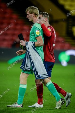 Harry Toffolo of Huddersfield consoles goalkeeper Ryan Schofield of Huddersfield at full time after his mistake cost Huddersfield the first goal scored by Tom Cleverley.; Vicarage Road, Watford, Hertfordshire, England; English Football League Championship Football, Watford versus Huddersfield Town.