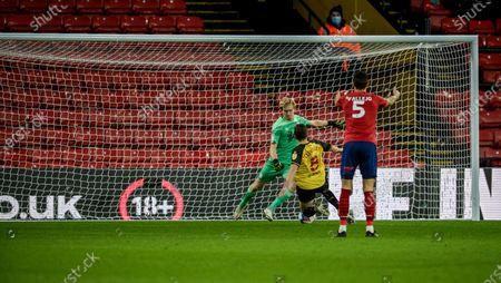 Tom Cleverley of Watford charges down the clearance from goalkeeper Ryan Schofield of Huddersfield to score for 1-0 in the 54th minute; Vicarage Road, Watford, Hertfordshire, England; English Football League Championship Football, Watford versus Huddersfield Town.