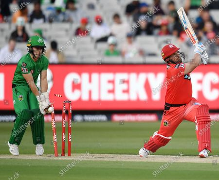 Glenn Maxwell of the Stars bowls out Aaron Finch of the Renegades swings and misses and is bowled out by Glenn Maxwell of the Stars; Melbourne Cricket Ground, Melbourne, Victoria, Australia; Big Bash League Cricket, Melbourne Stars versus Melbourne Renegades.