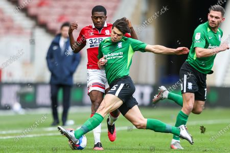 Birmingham City defender George Friend (5) tackles Middlesbrough defender Anfernee Dijksteel (2) during the EFL Sky Bet Championship match between Middlesbrough and Birmingham City at the Riverside Stadium, Middlesbrough