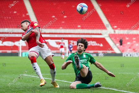 Birmingham City defender George Friend (5) clears the ball ahead of Middlesbrough midfielder Marcus Tavernier (7)  during the EFL Sky Bet Championship match between Middlesbrough and Birmingham City at the Riverside Stadium, Middlesbrough