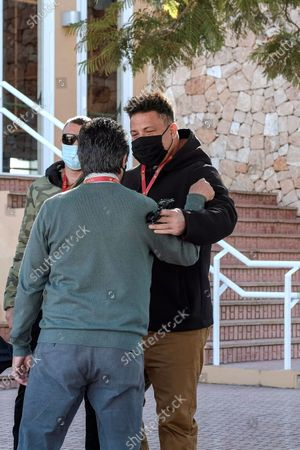 Real Valladolid's president, Brazilian soccer legend Ronaldo Nazario (R) is welcomed upon his arrival at the town of Santa Eulalia, Ibiza island, Spain, 16 January 2021. Real Valladolid will face Pena Deportiva in their Spanish King's Cup round of 32 soccer match.