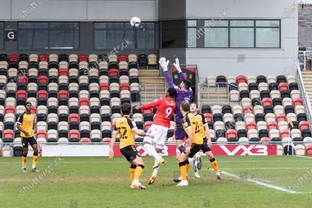 Newport County's Goalkeeper Tom King (1) under pressure from Salford City's Tom Elliott (9) during the EFL Sky Bet League 2 match between Newport County and Salford City at Rodney Parade, Newport