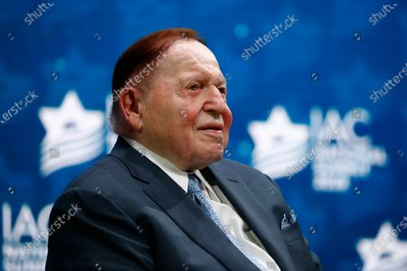 Las Vegas Sands Corporation Chief Executive Sheldon Adelson sits onstage before President Donald Trump speaks at the Israeli American Council National Summit in Hollywood, Fla. One of the most influential Republican megadonors, Adelson, died Jan. 11, 2021. That puts more pressure on the NRSC and the leading Senate Republican outside group, Senate Leadership Fund, to cover the difference