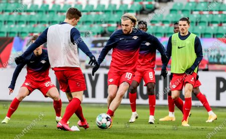 Stock Photo of Leipzig's Emil Forsberg (C) and teammates warm up for the German Bundesliga soccer match between VfL Wolfsburg and RB Leipzig in Wolfsburg, Germany, 16 Januar 2021.