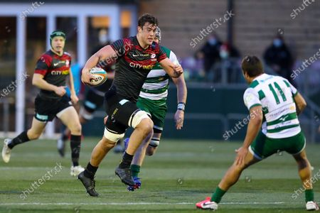 Callum Hunter-Hill of Saracens surges towards the try line