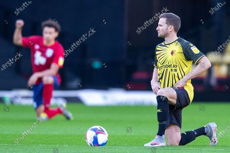 Watford midfielder Tom Cleverley (8) takes the knee before the EFL Sky Bet Championship match between Watford and Huddersfield Town at Vicarage Road, Watford