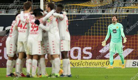 Dortmund's goalkeeper Roman Buerki (R) reacts after the first goal of Mainz during the German Bundesliga soccer match between Borussia Dortmund and 1. FSV Mainz 05 at Signal Iduna Park in Dortmund, Germany, 16 January 2021.