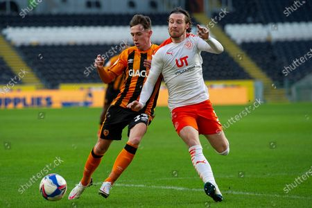 Gavin Whyte of Hull City James Husband of Blackpool gives chase during the EFL Sky Bet League 1 match between Hull City and Blackpool at the KCOM Stadium, Kingston upon Hull