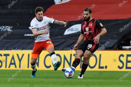 Cameron Carter-Vickers (18) of AFC Bournemouth on the attack chased by James Collins (19) of Luton Town during the EFL Sky Bet Championship match between Bournemouth and Luton Town at the Vitality Stadium, Bournemouth