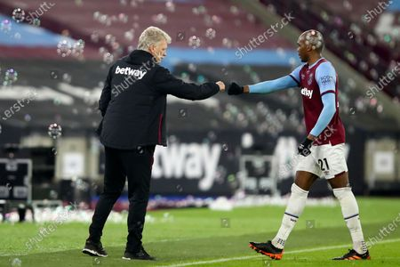 West Ham's Angelo Ogbonna bumps fists with West Ham's manager David Moyes at the end of the English Premier League soccer match between West Ham United and Burnley, at London stadium, in London