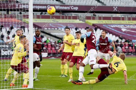 West Ham's Angelo Ogbonna, 3rd right, hits the post during the English Premier League soccer match between West Ham United and Burnley, at London stadium, in London